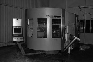 What are the main components of CNC machine tools